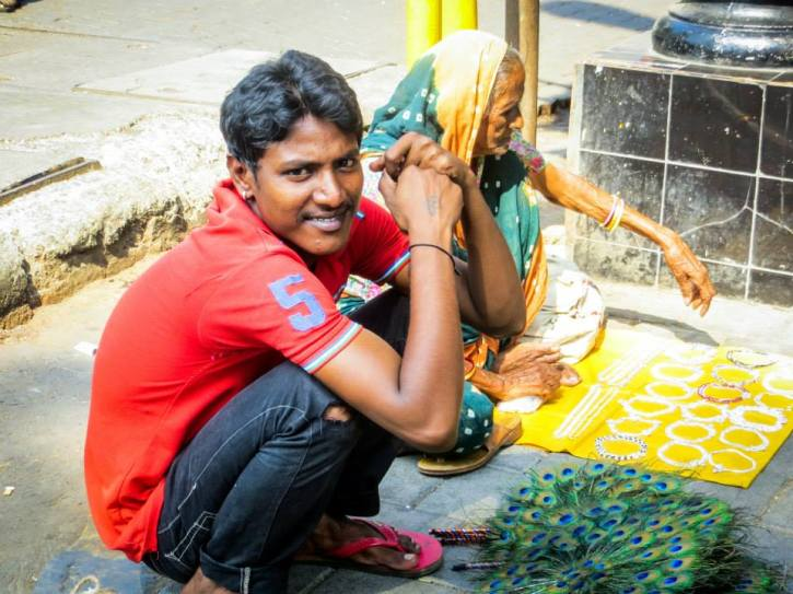 Vendor in Mumbai selling Peacock feathers